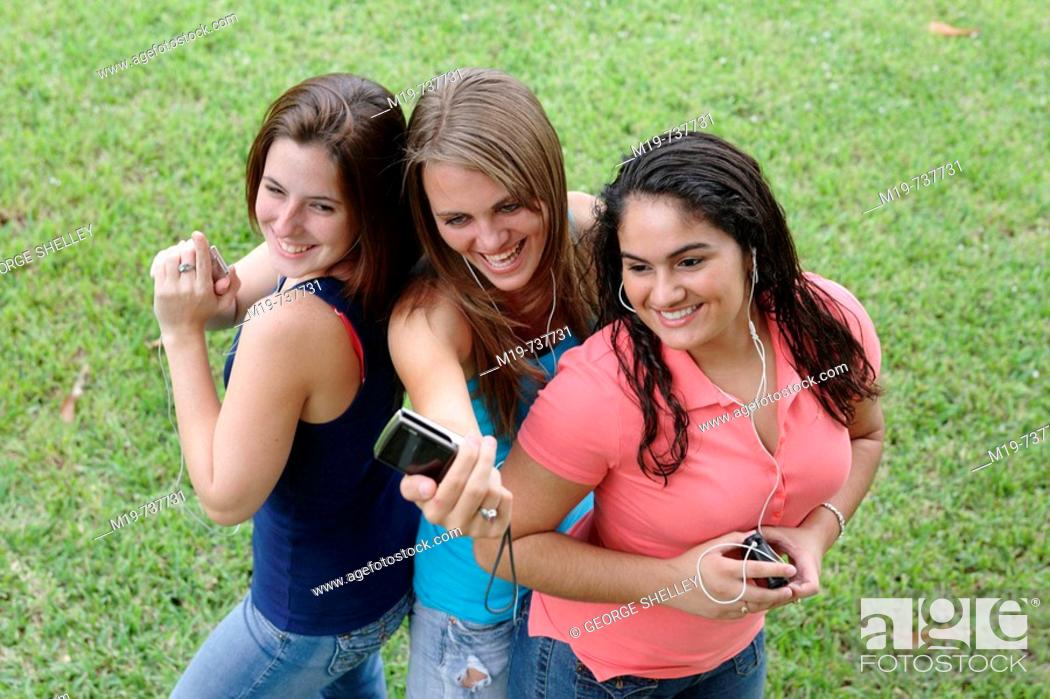 Stock Photo: Group of teens taking a picture or themselves.