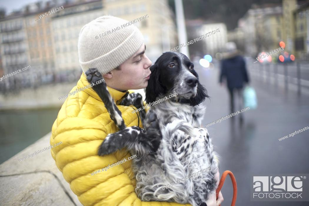 Stock Photo: young man with dog in Lyon, France.