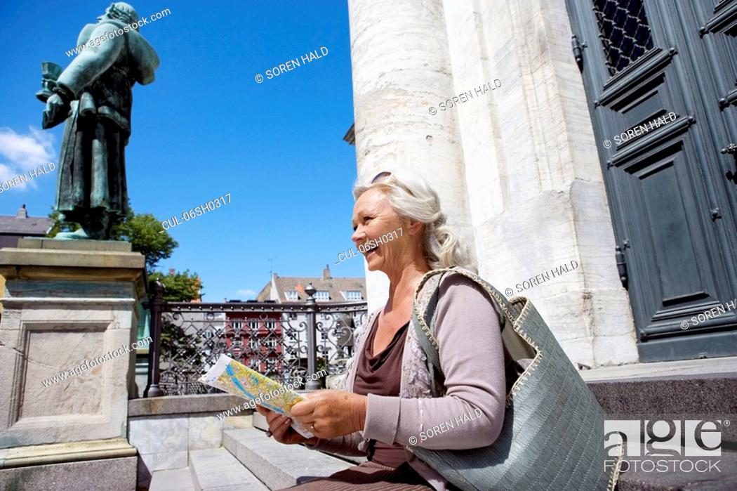 Stock Photo: Woman sitting with map.