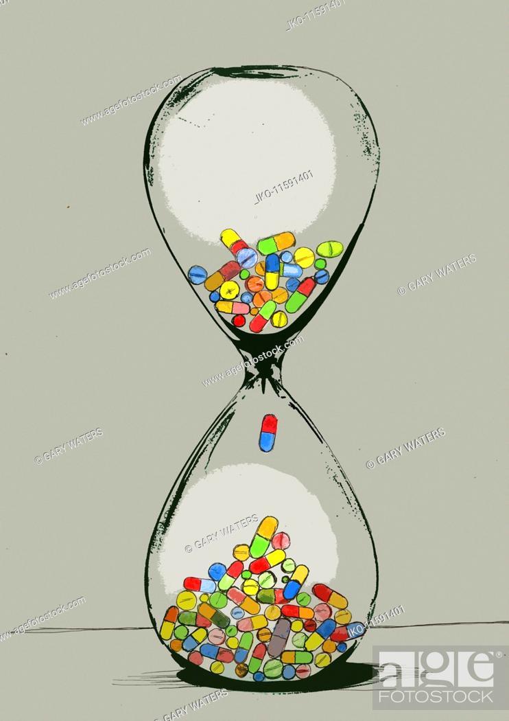 Stock Photo: Pills inside of hourglass.