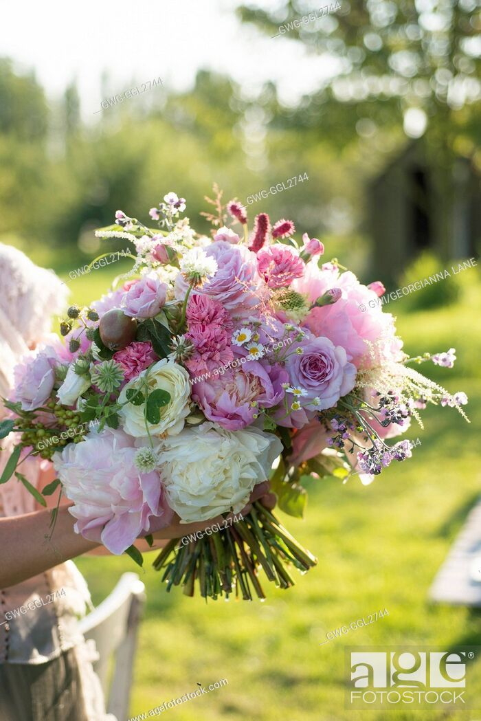 Stock Photo: PAEONIA LACTIFLORA BOWL OF BEAUTY WITH ROSES CARNATIONS SCABIOSA AND SEED HEADS IN BOUQUET.