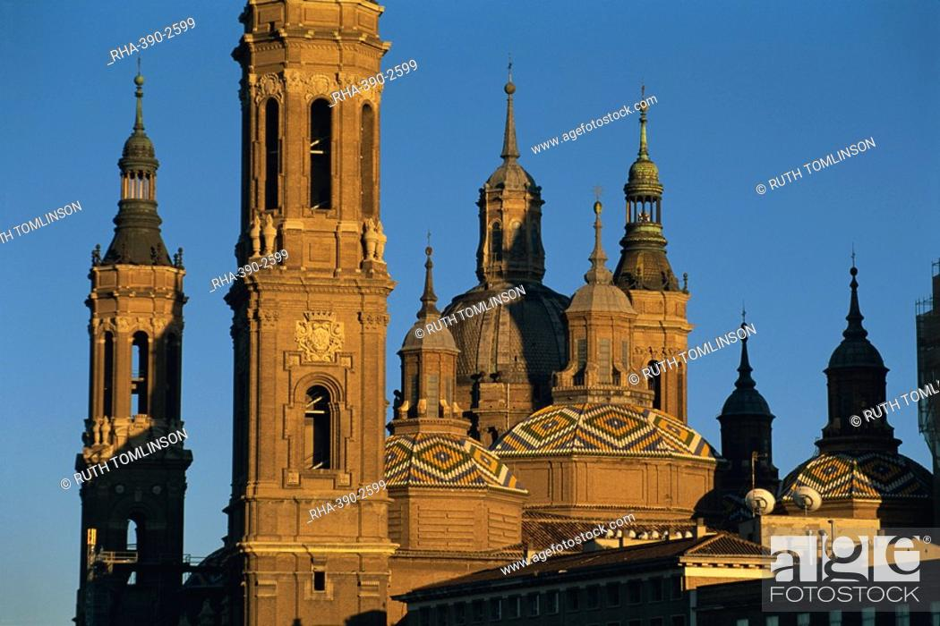 Stock Photo: The towers, spires and tiled roogs of the Basilica of Nuestra Senora del Pilar at sunset, Zaragoza, Aragon, Spain, Europe.