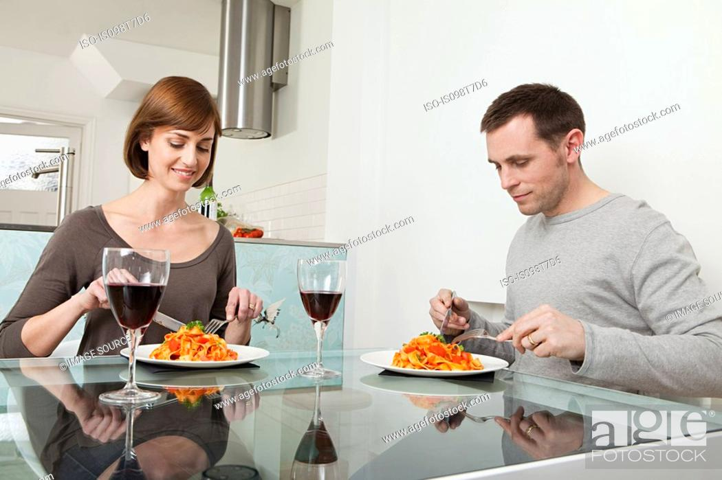 Stock Photo: Couple having meal and wine.