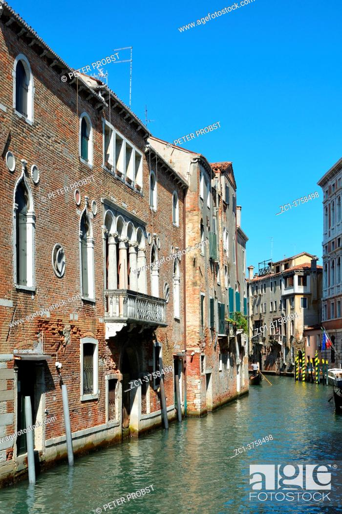 Stock Photo: Venetian canal in the disdrict San Polo of Venice with ancient buildings - Italy.