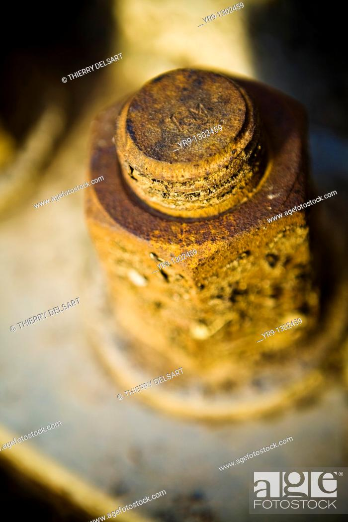 Stock Photo: Rusted bolt of the basement of a light tower.