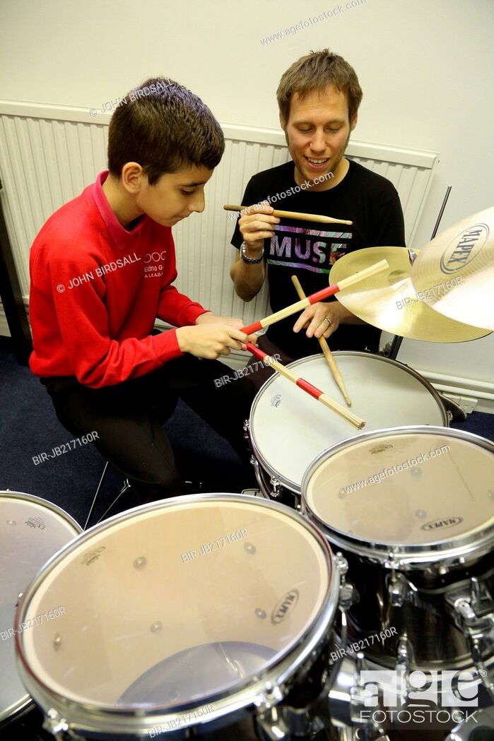 Stock Photo: Visually impaired boy being given drumming lessons at My Sight charity, Nottingham.