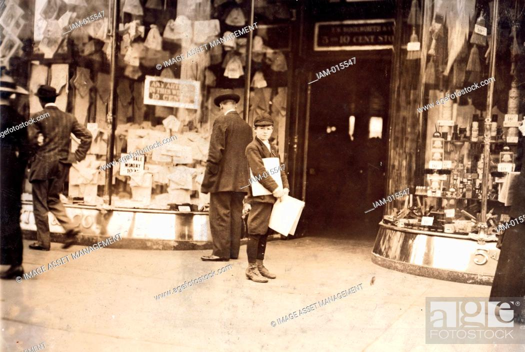 Stock Photo: A young truant selling extras during school hours. Pennsylvania Avenue New York 1911.