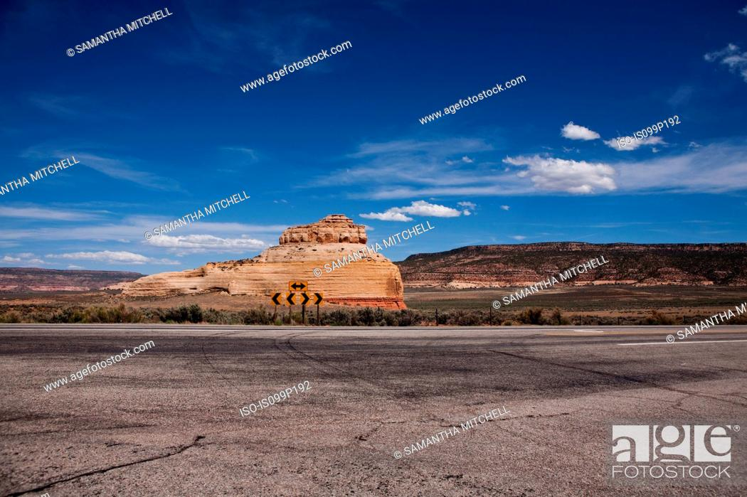 Stock Photo: Arrow sign in front of rock formation, Indian Creek Recreation Area, Utah, USA.