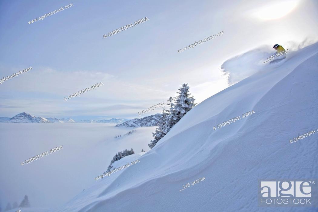 Stock Photo: Snowboarder in deep snow, Hahnenkamm, Kitzbuehel, Tyrol, Austria.