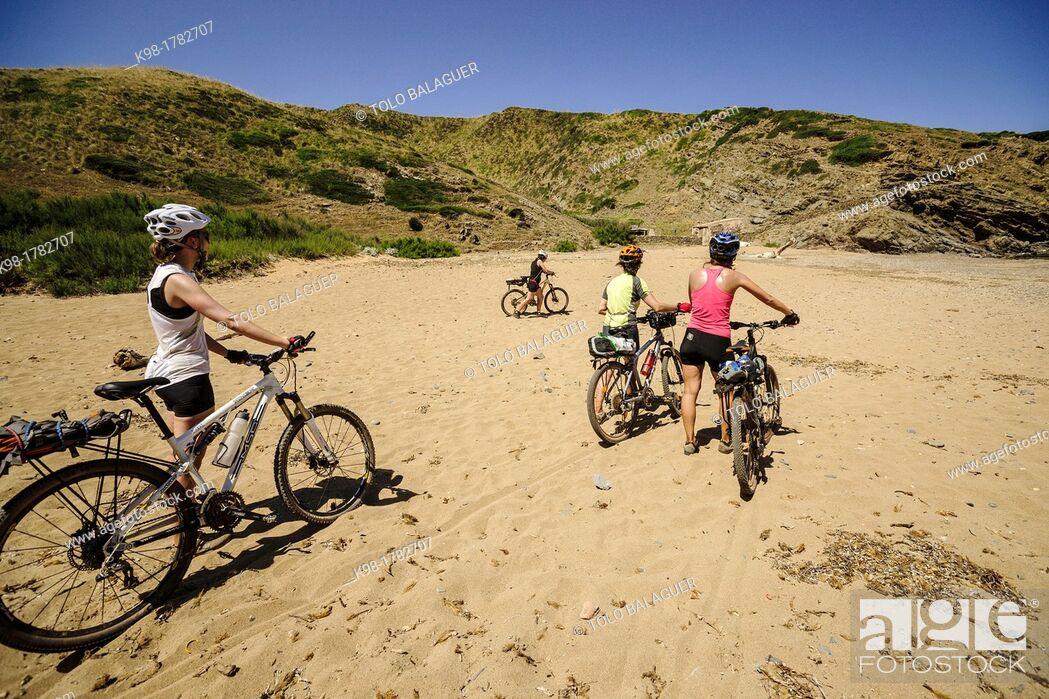 Stock Photo: Cyclists, Cala En Calderer, Ferreries, Menorca, Balearic Islands, Spain, Europe.