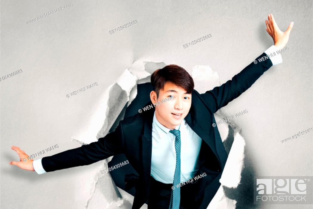Stock Photo: asian businessman Breakthrough paper hole.