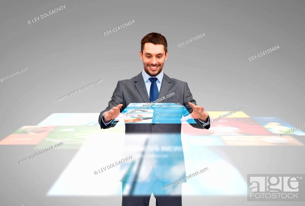 Stock Photo: business, multimedia, technology and people concept - smiling businessman working with news projection on virtual screen.