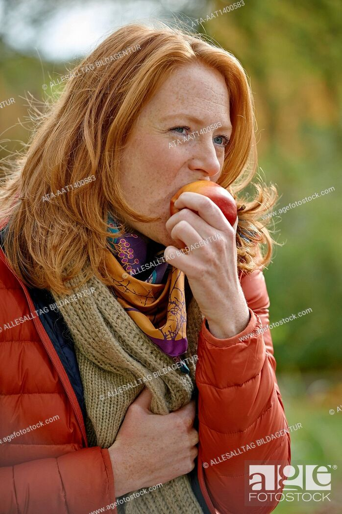 Stock Photo: Woman eating an apple.