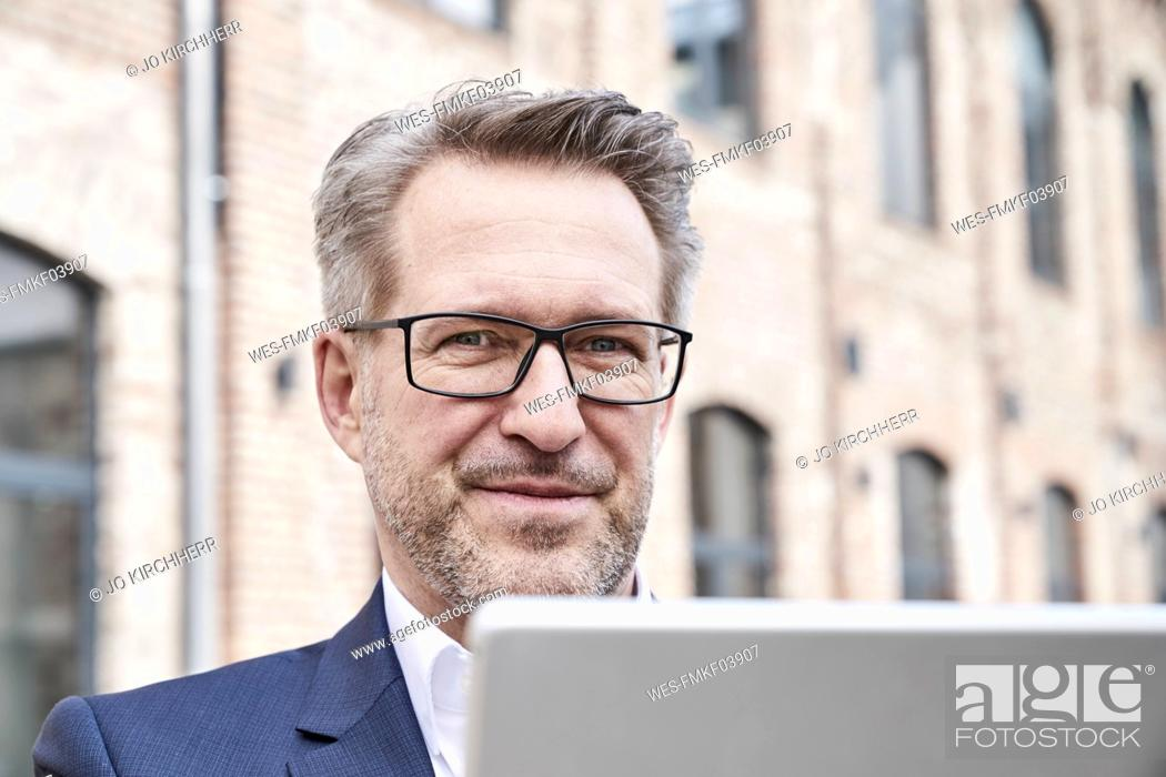 Stock Photo: Portrait of businessman with tablet.