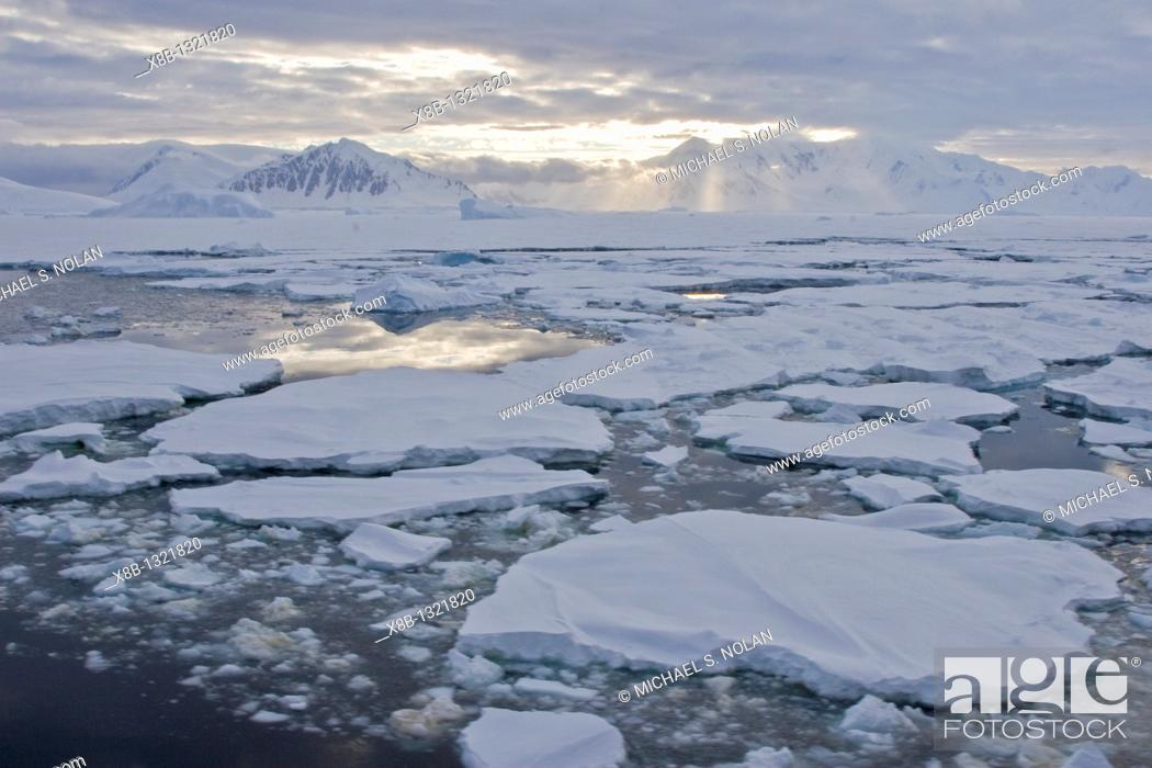 Stock Photo: Brash ice and first year floe ice often called pancake ice south of the Antarctic Circle on the west side of the Antarctic Peninsula during the summer months.