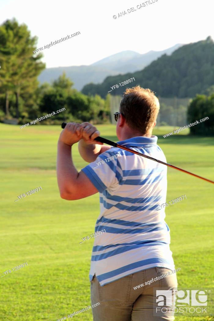 Stock Photo: Drive Golf lessons Golf course La Sella Denia Alicante Spain.