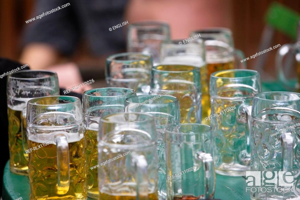 Stock Photo: Table full of litre beer mugs, English garden, Munich, Germany.