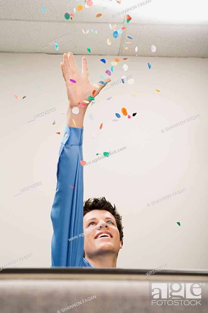 Stock Photo: Businessman throwing confetti.
