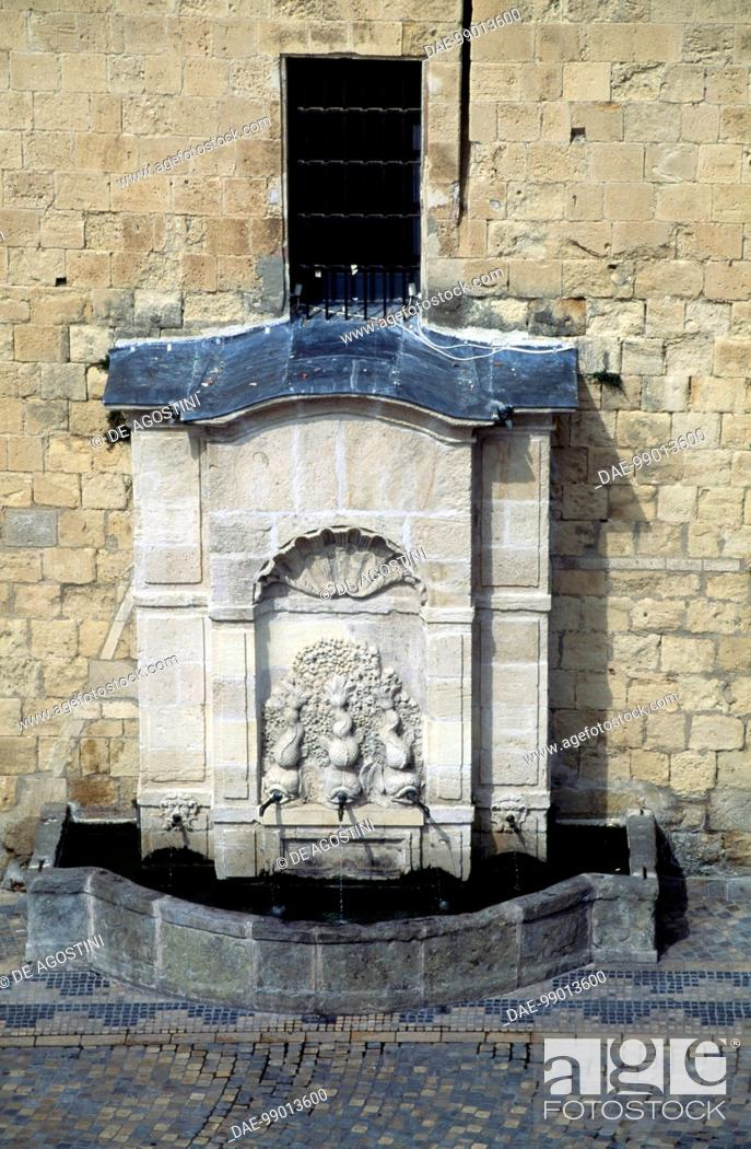 Stock Photo: Stone fountain at the base of Gilles Aycelin dungeon, 1290-1311, Place de l'Hotel de Ville, Narbonne, Languedoc-Roussillon, France.