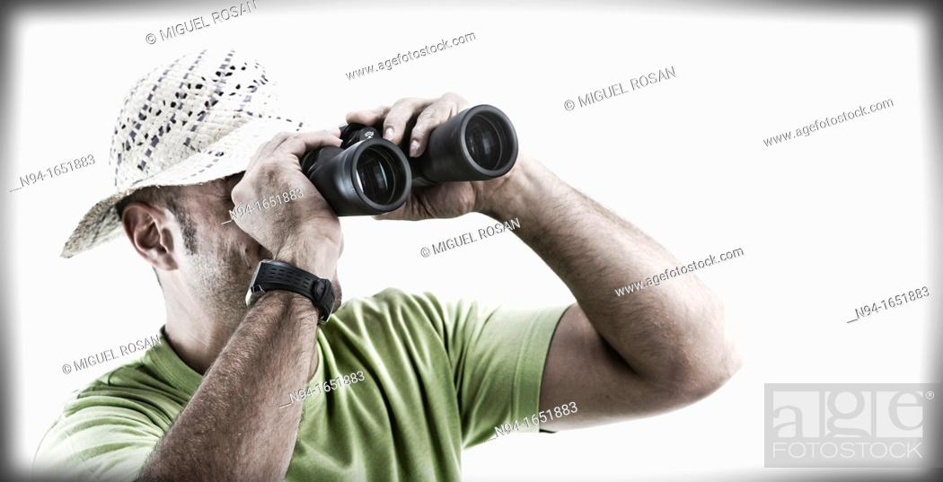 Stock Photo: Closeup of man with hat looking through binoculars.