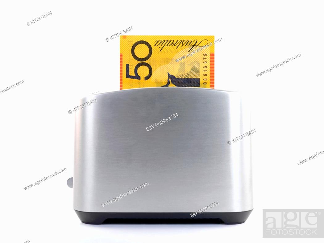 Stock Photo: A toaster popping up an Australian twenty dollare note.