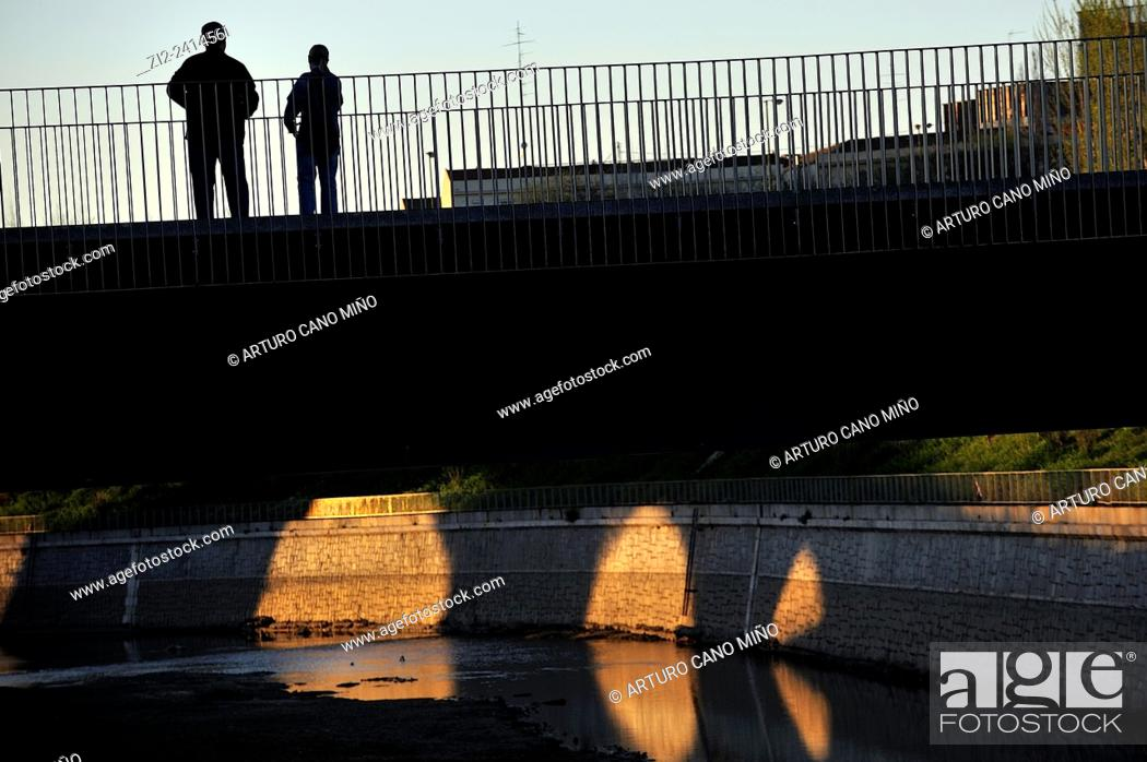 Stock Photo: A footbridge over the River Manzanares, at dusk. Madrid, Spain.