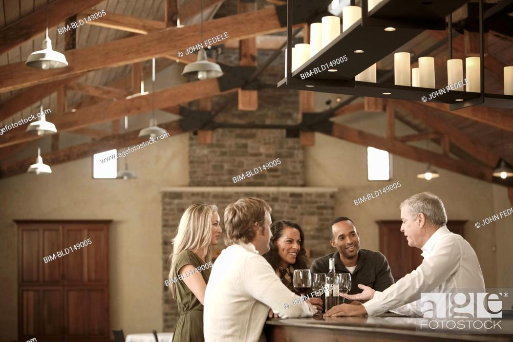 Stock Photo: Friends drinking wine together.