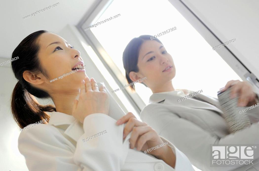 Stock Photo: Woman who waits for the elevator.