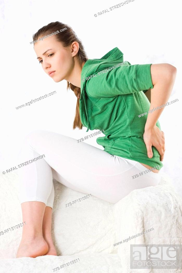 Stock Photo: young woman with back pain.