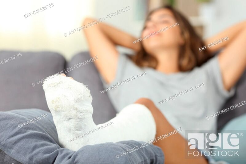 Stock Photo: Satisfied disabled woman resting sitting on a couch in the living room at home.