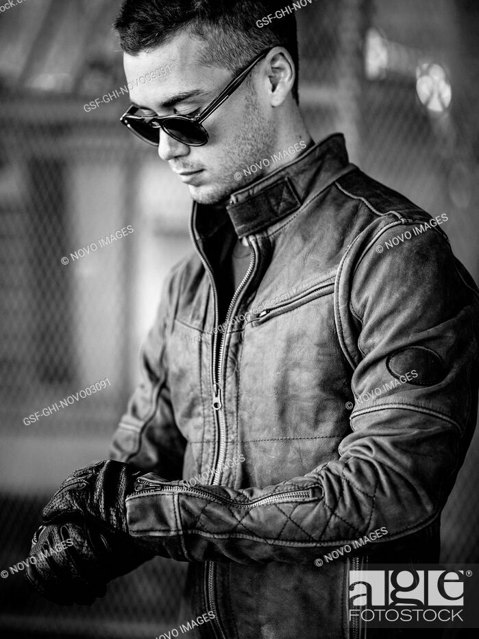 Imagen: Portrait of Young Adult Man Wearing Sunglasses and Leather Jacket.