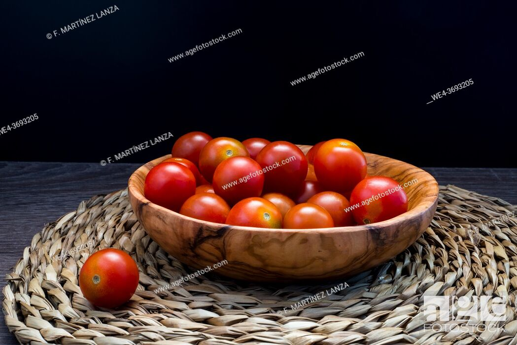 Stock Photo: Cherry tomatoes on a plate.