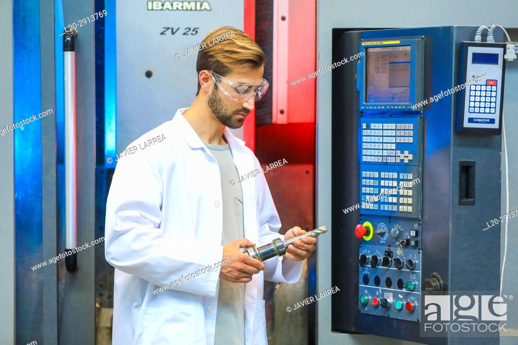Stock Photo: Machine tool for 5-axis milling, Researcher in machining center, Industry, Tecnalia Research & innovation, Technology and Research Centre.