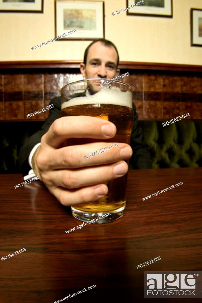 Stock Photo: Businessman drinking a pint of lager.