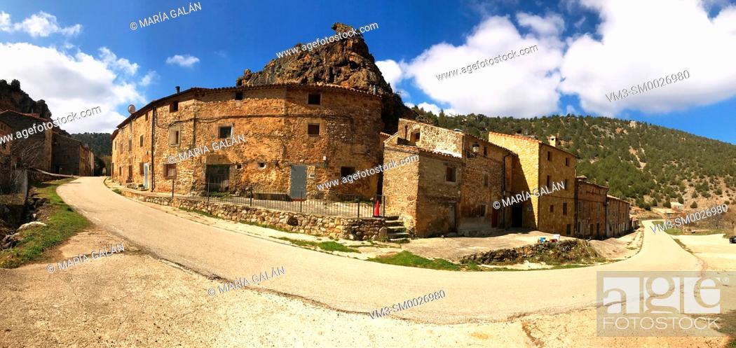 Stock Photo: Road and village, panoramic image. Chaorna, Soria province, Castilla Leon, Spain.