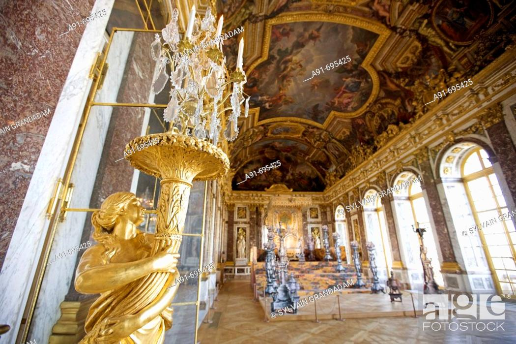 Golden Statues Holding Lamps In The Hall Of Mirrors Palace Of