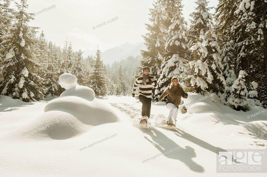 Stock Photo: Austria, Salzburg State, Altenmarkt-Zauchensee, Couple snowshoeing in winter landscape.