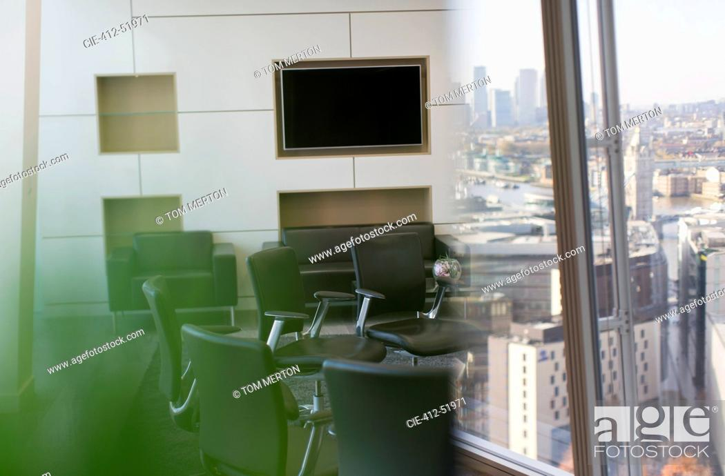 Stock Photo: Chairs in circle in modern city conference room.