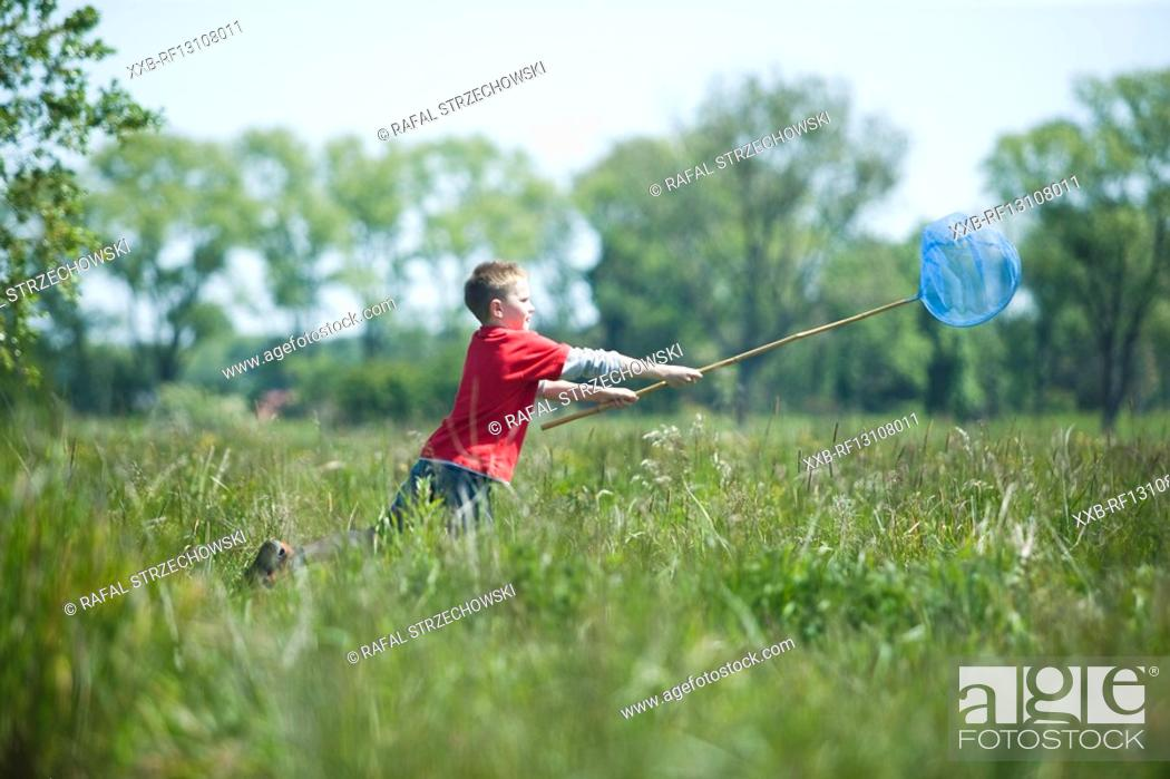 Stock Photo: boy playing on meadow.