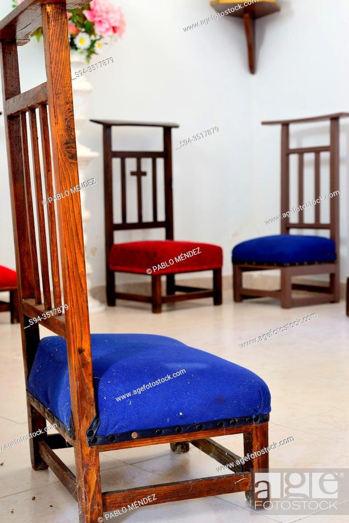Stock Photo: Chairs into the church of Santiago, Mouruas, San Xoan de Rio, Orense, Spain.