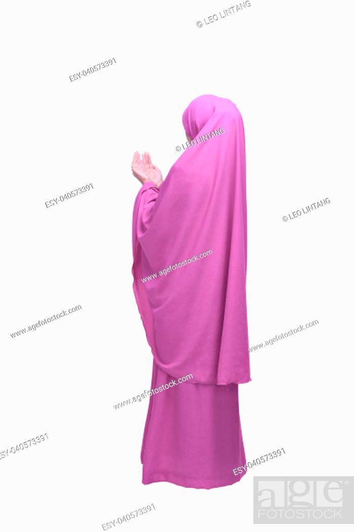 Stock Photo: Portrait of asian muslim woman praying to god posing isolated over white background.