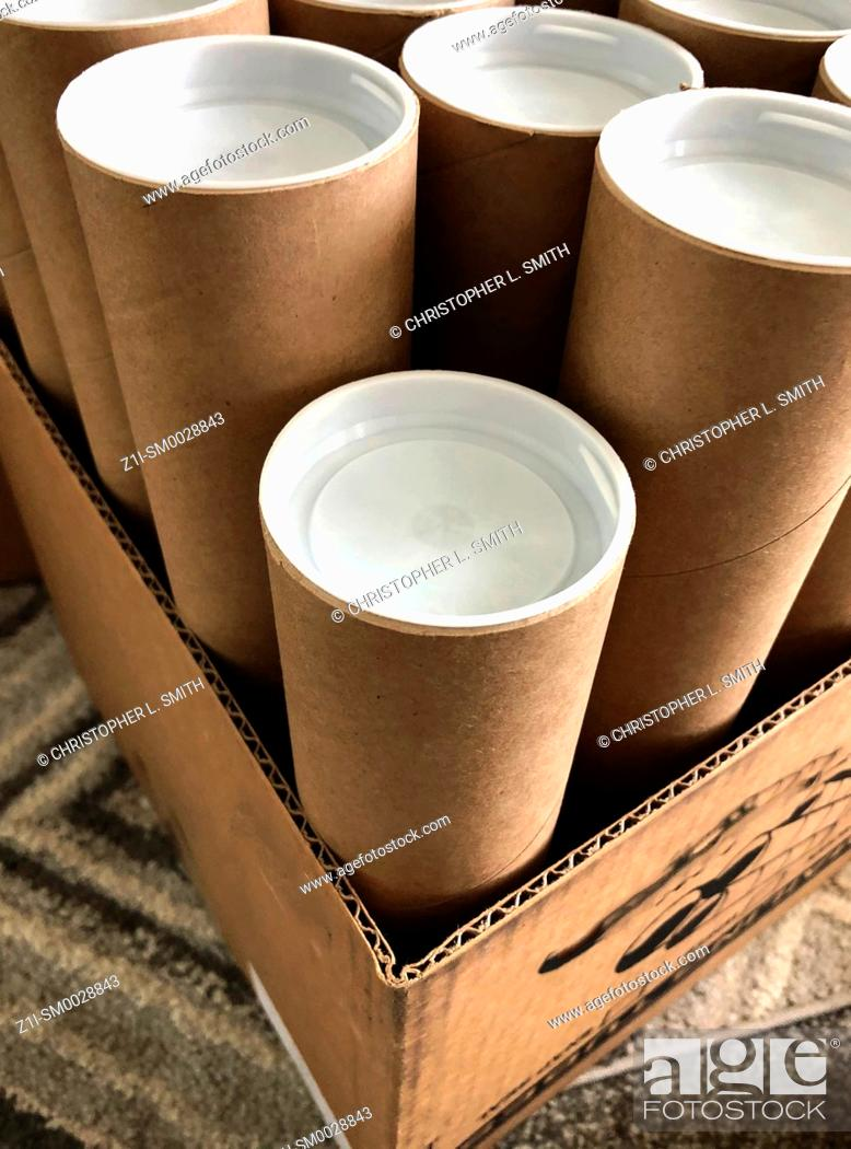 Stock Photo: Recycled cardboard mailer tubes with white plastic end caps.