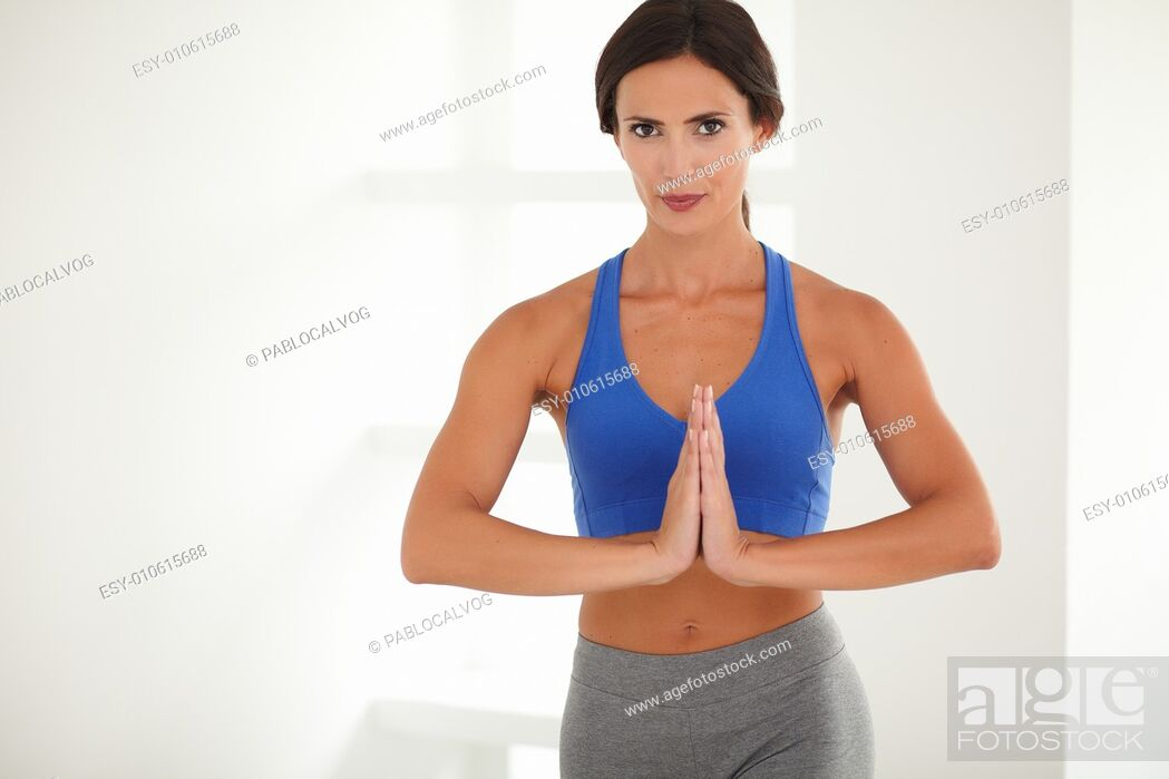 Stock Photo: Pretty young lady in sport clothing doing sports training for wellbeing - copyspace.