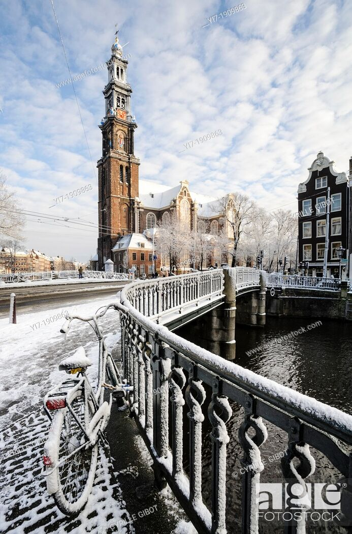 Stock Photo: Amsterdam in winter. Westerkerk and bridge over Prinsengracht canal, Amsterdam, the Netherlands.