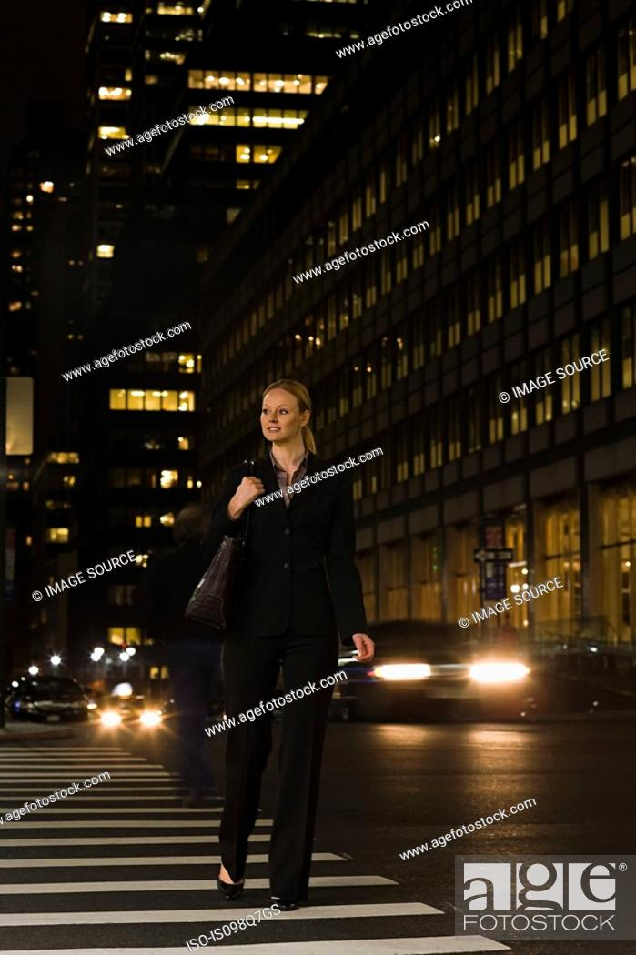 Stock Photo: Businesswoman crossing the street.