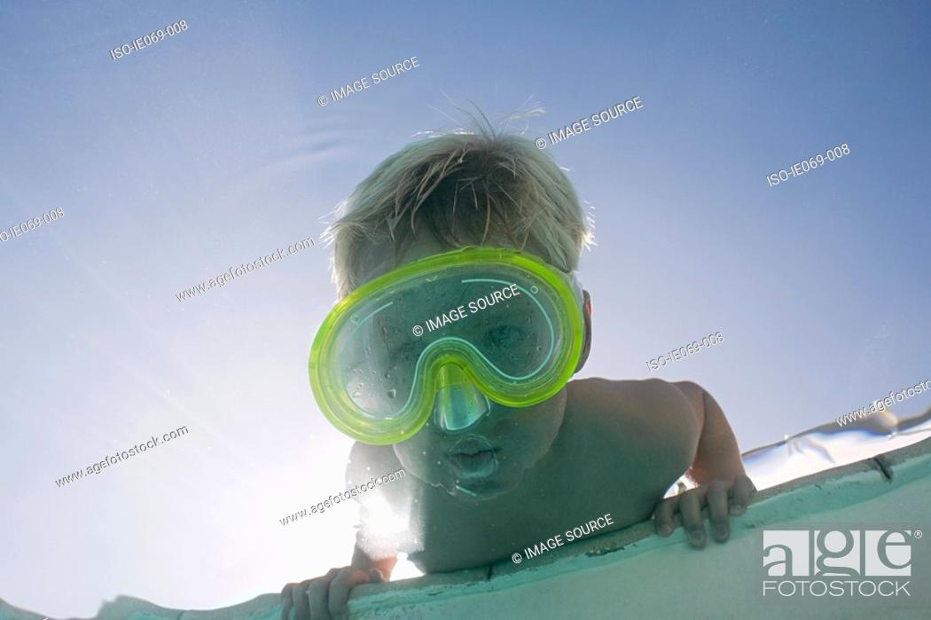 Stock Photo: Boy putting face underwater.