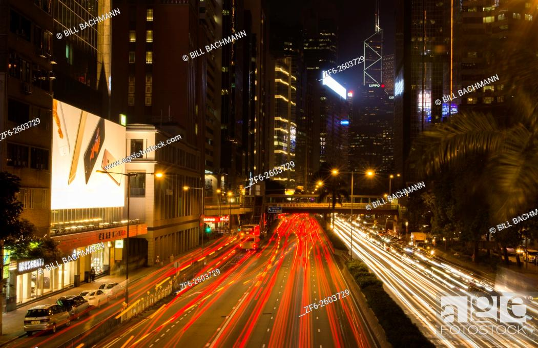 Stock Photo: Hong Kong China downtown twilight traffic in Gloucester Road at night with cars streaking on road with skyscrapers on sides of Central Hong Kong District.