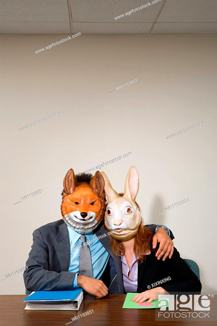 Stock Photo: Colleagues wearing masks.