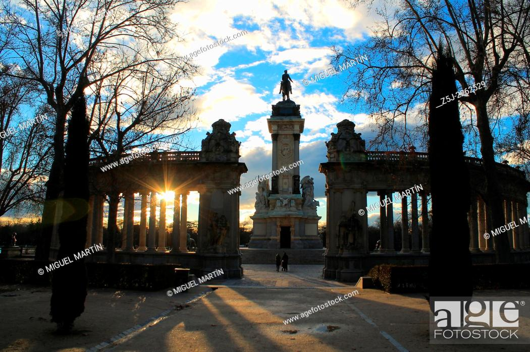 Stock Photo: Sunset behind the monument to Alfonso XII of Spain in Retiro Park at Madrid, built in memory of the king that not only restored Borbón Spanish dinasty in 1875.