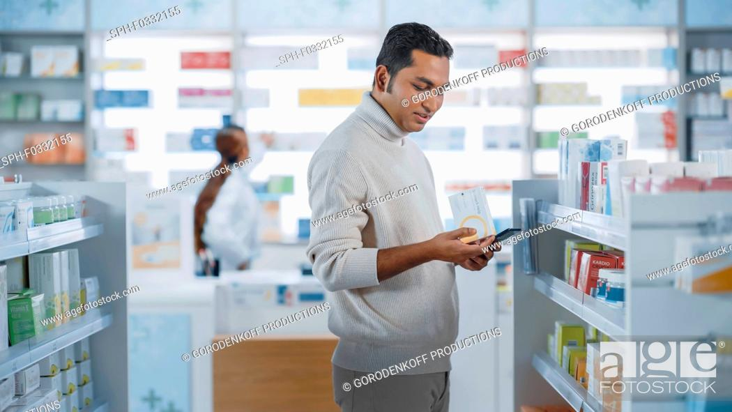 Stock Photo: Customer using a smartphone in a pharmacy.